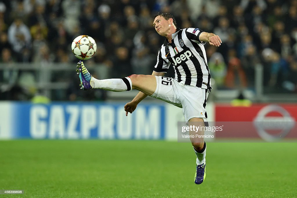 Stephan Lichtsteiner of Juventus controls the ball during the UEFA Champions League group A match between Juventus and Olympiacos FC at Juventus Arena on November 4, 2014 in Turin, Italy.
