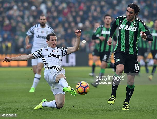 Stephan Lichtsteiner of Juventus FC and Alessandro Matri of US Sassuolo in action during the Serie A match between US Sassuolo and Juventus FC at...