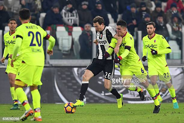 Stephan Lichtsteiner of Juventus FC competes with Federico Viviani of Bologna FC during the Serie A match between Juventus FC and Bologna FC at...