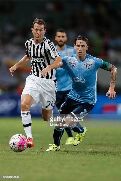 Stephan Lichtsteiner of Juventus FC contests the ball against Lucas Biglia of Lazio during the Italian Super Cup final football match between...