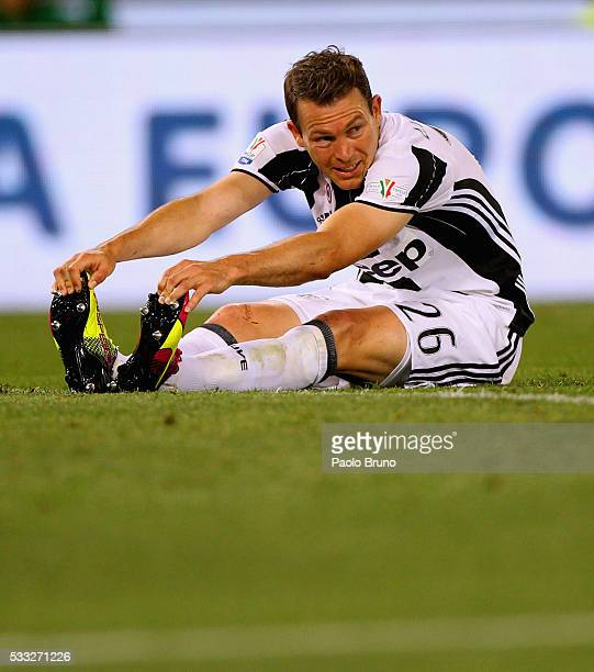 Stephan Lichtsteiner of Juventus FC is Injured during the TIM Cup final match between AC Milan and Juventus FC at Stadio Olimpico on May 21 2016 in...