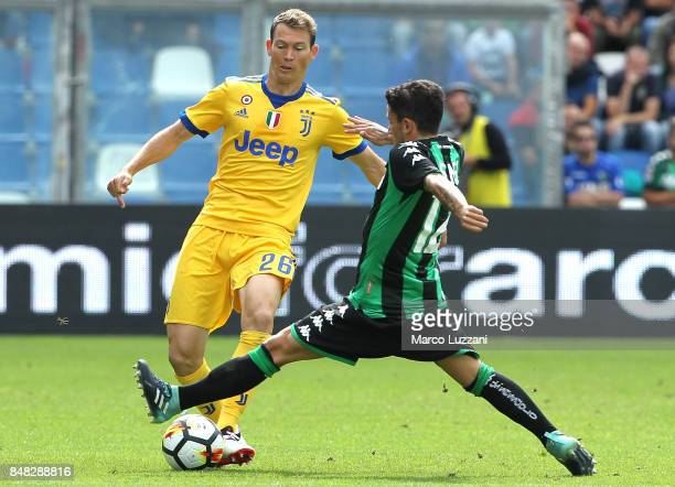Stephan Lichtsteiner of Juventus is challenged by Stefano Sensi of US Sassuolo Calcio during the Serie A match between US Sassuolo and Juventus at...