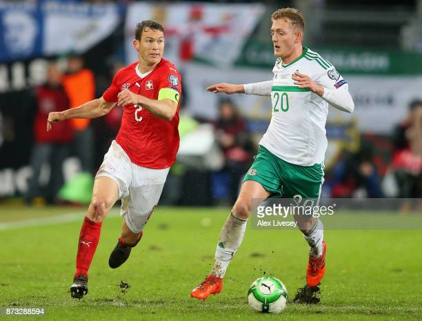 Stephan Lichtsteiner of Switzerland and George Saville of Northern Ireland in action during the FIFA 2018 World Cup Qualifier PlayOff Second Leg...