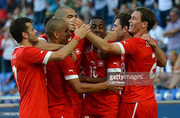 Stephan Lichtsteiner of Switzerland celebrates with team mates after scoring his teams fourth goal during the international friendly match between...