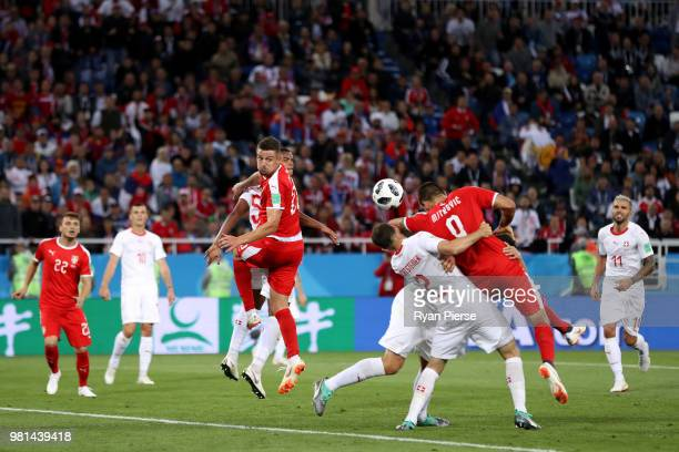 Stephan Lichtsteiner of Switzerland collides with Aleksandar Mitrovic of Serbia inside the penalty area during the 2018 FIFA World Cup Russia group E...