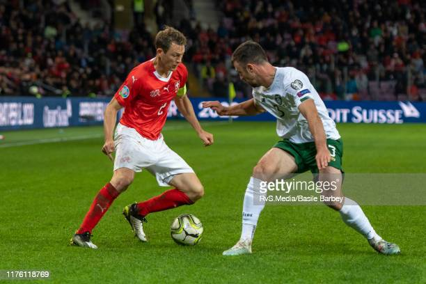 Stephan Lichtsteiner of Switzerland competes for the ball with Enda Stevens of Republic of Ireland during Switzerland and Republic of Ireland on...