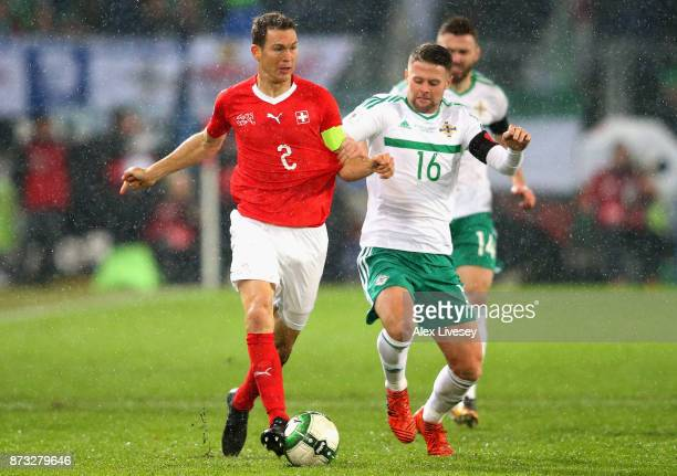 Stephan Lichtsteiner of Switzerland is closed down by Oliver Norwood of Northern Ireland during the FIFA 2018 World Cup Qualifier PlayOff Second Leg...
