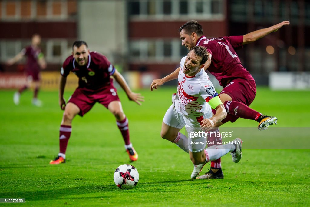 Stephan Lichtsteiner of Switzerland is fouled by Vitalijs Maksimenko of Latvia during the FIFA 2018 World Cup Qualifier between Latvia and Switzerland at Skonto Stadium on September 3, 2017 in Riga, Latvia.