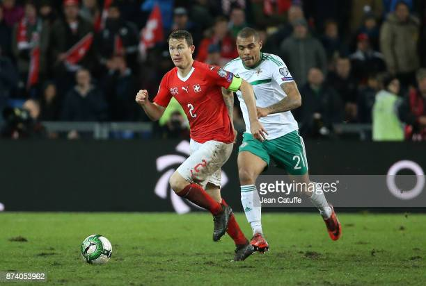 Stephan Lichtsteiner of Switzerland Josh Magennis of Northern Ireland during the FIFA 2018 World Cup Qualifier PlayOff Second Leg between Switzerland...