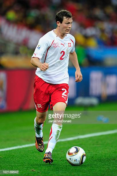 Stephan Lichtsteiner of Switzerland runs with the ball during the 2010 FIFA World Cup South Africa Group H match between Spain and Switzerland at...