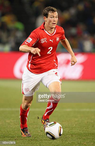Stephan Lichtsteiner of Switzerland runs with the ball during the 2010 FIFA World Cup South Africa Group H match between Switzerland and Honduras at...