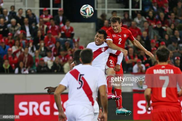 Stephan Lichtsteiner of Switzerland scores a goal against Rinaldo Cruzado of Peru during the international friendly match between Switzerland and...