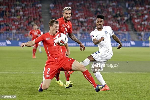 Stephan Lichtsteiner of Switzerland Valon Behrami of Switzerland Raheem Sterling of England during the EURO 2016 qualifying match between Switzerland...