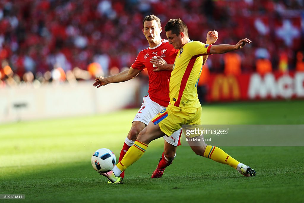 Stephan Lichtsteiner of Switzerland vies with Steliano Filip of Romania during the UEFA EURO 2016 Group A match between Romania and Switzerland at Parc des Princes on June 15, 2016 in Paris, France.