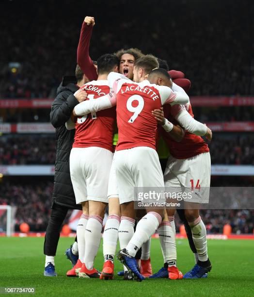 Stephan Lichtsteiner Sead Kolasinac and Matteo Guendouzi celebrate the 3rd Arsenal goal Alex Lacazette during the Premier League match between...