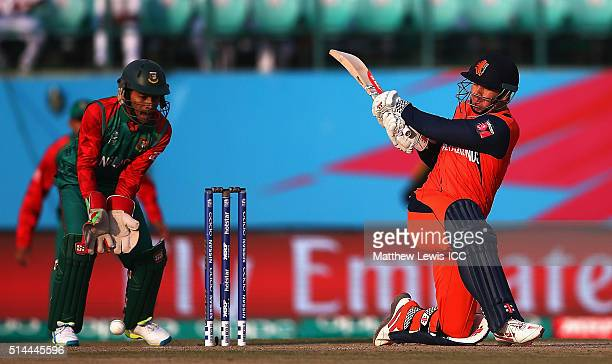 Stephan Myburgh of the Netherlands pulls the ball towards the boundary as Mushfiqur Rahim of Bangladesh looks on during the ICC Twenty20 World Cup...
