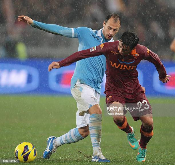 Stephan Radu of SS Lazio competes for the ball with Ivan Piris of AS Roma during the Serie A match between SS Lazio and AS Roma at Stadio Olimpico on...
