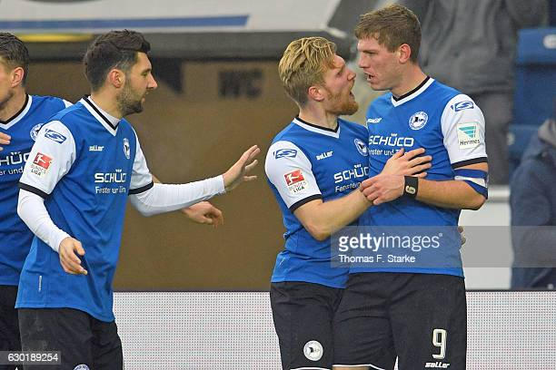Stephan Salger Andreas Voglsammer and Fabian Klos of Bielefeld celebrate during the Second Bundesliga match between DSC Arminia Bielefeld and SG...