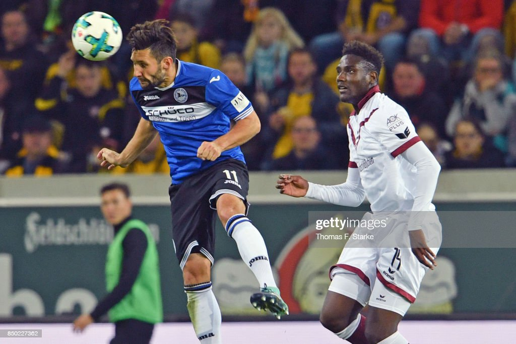 Stephan Salger (L) of Bielefeld and Peniel Mlapa of Dresden head for the ball during the Second Bundesliga match between SG Dynamo Dresden and DSC Arminia Bielefeld at DDV-Stadion on September 20, 2017 in Dresden, Germany.