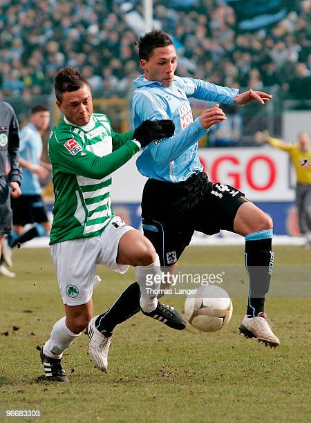 Stephan Schroeck of Fuerth and Jose Holebas of Muenchen battle for the ball during the 2nd Bundesliga match between SpVgg Greuther Fuerth and TSV...