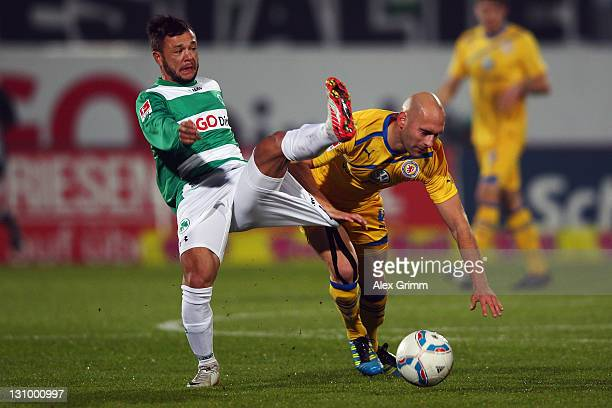 Stephan Schroeck of Greuther Fuerth is challenged by Damir Vrancic of Braunschweig during the Second Bundesliga match between Greuther Fuerth and...