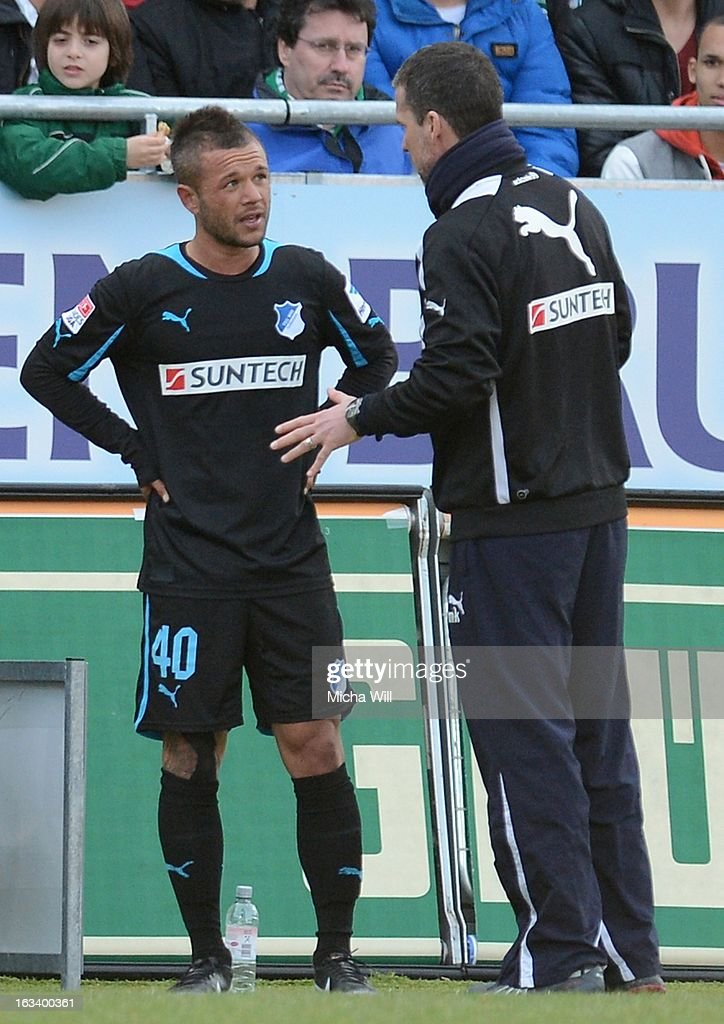 Stephan Schroeck (L) of Hoffenheim speaks to headcoach Marco Kurz of Hoffenheim after his substitution during the Bundesliga match between SpVgg Greuther Fuerth and TSG 1899 Hoffenheim at Trolli-Arena on March 9, 2013 in Fuerth, Germany.