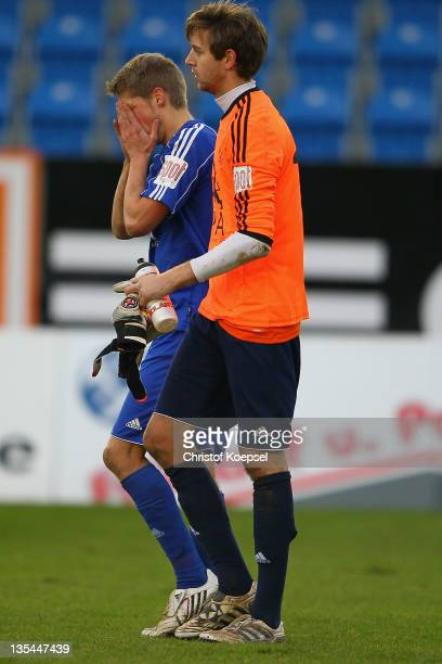 Stephan Tantow and Marc Lorenz look dejected after losing the Regionalliga West match between Sportfreunde Lotte and Eintracht Trier at connectMArena...