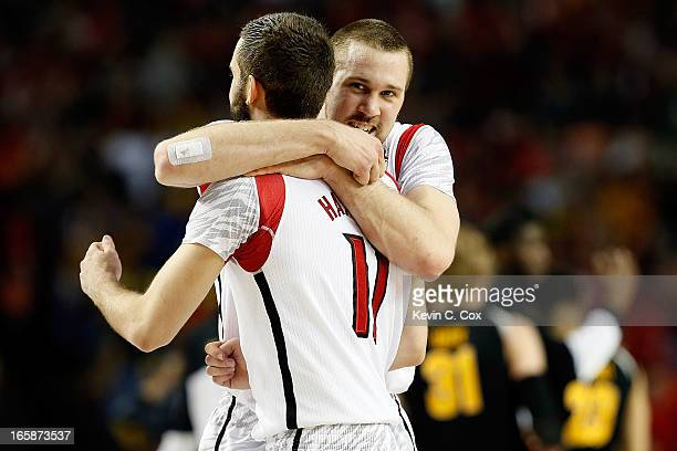 Stephan Van Treese hugs Luke Hancock of the Louisville Cardinals after the Cardinals defeat the Wichita State Shockers 7268 in the 2013 NCAA Men's...