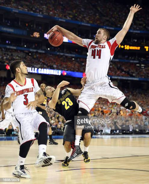 Stephan Van Treese of the Louisville Cardinals blocks a shot attemptm in the second hal fagainst Fred VanVleet of the Wichita State Shockers during...