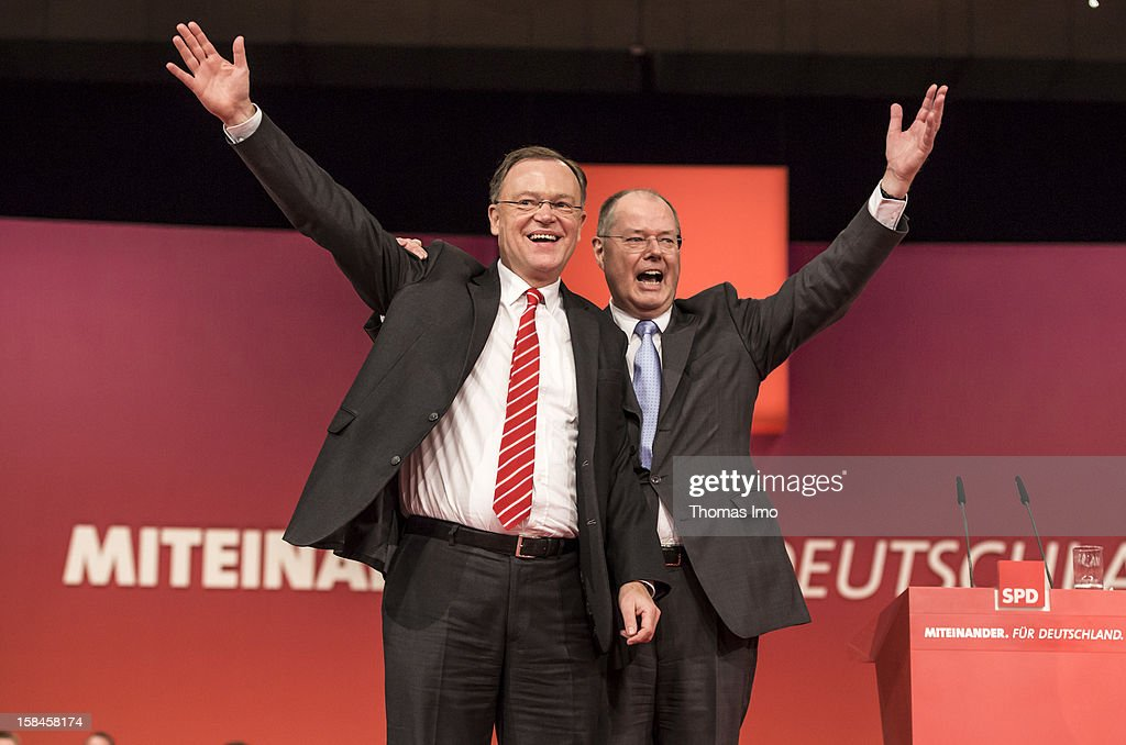Stephan Weil (L), Candidate of SPD for the election in lower saxony and Peer Steinbrueck, chancellor candidate of the German Social Democrats (SPD) gestures at the SPD federal party convention on December 9, 2012 in Hanover, Germany. The SPD is convening to set its policy course for the next year and to celebrate Steinbrueck, who will run for chancellor in elections set for 2013.