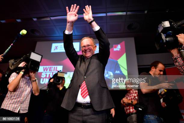 Stephan Weil, incumbent candidate of the German Social Democrats , speaks and celebrates with supporters following initial results that give the SPD...