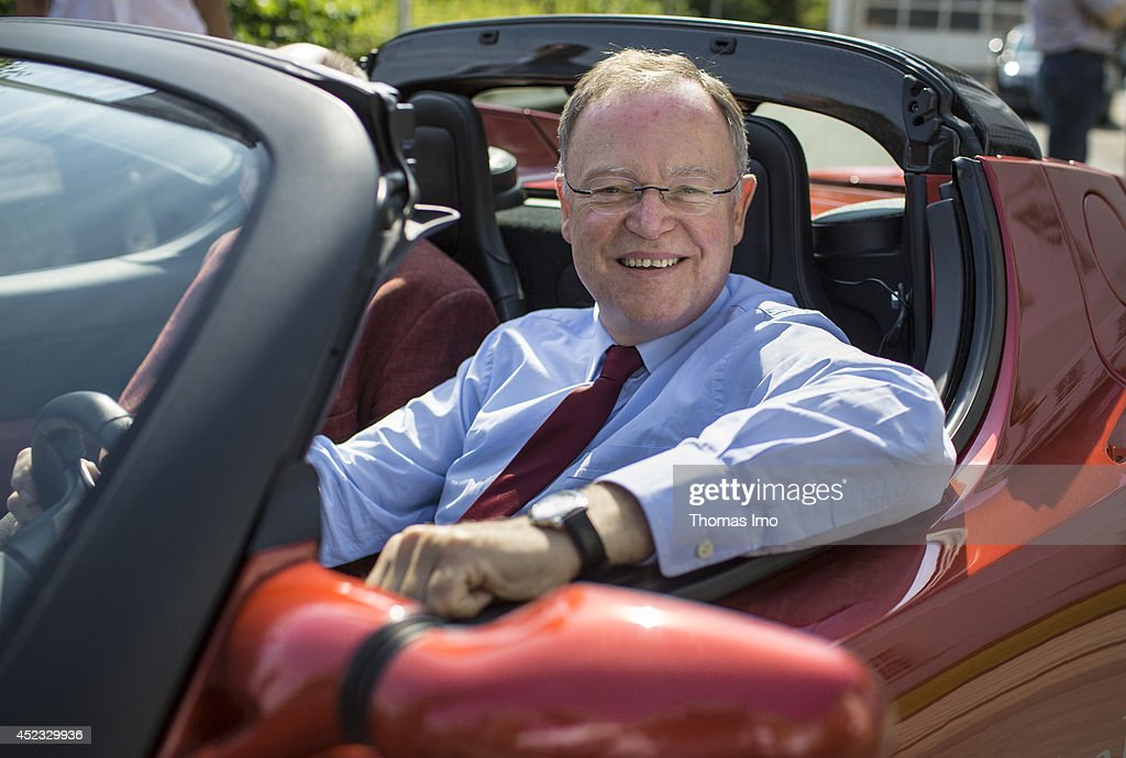 Stephan Weil, Prime Minister of German State Lower-Saxony, drives a Tesla Roadster electric vehicle during his visit to Energy Research Center Lower Saxony (Energieforschungszentrum Niedersachsen) as part of his summertour through lower saxony on July 18, 2014 in Goslar, Germany.