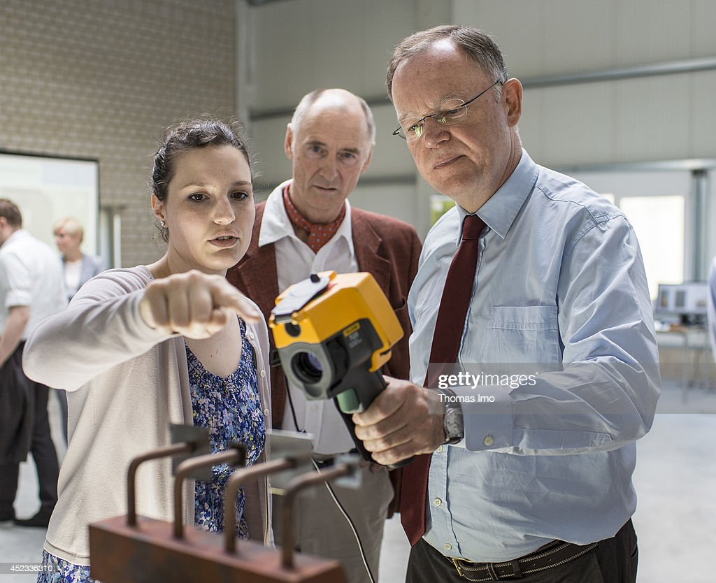 Stephan Weil, Prime Minister of German State Lower-Saxony, holds an infrared camera to test the heat conduction in LED lights during his visit to Energy Research Center Lower Saxony (Energieforschungszentrum Niedersachsen) as part of his summertour through lower saxony on July 18, 2014 in Goslar, Germany.