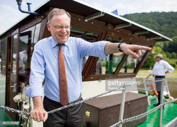 Stephan Weil, Prime Minister of German State Lower-Saxony, stands on deck of a boat during his summertour through lower saxony on July 16, 2014 in...