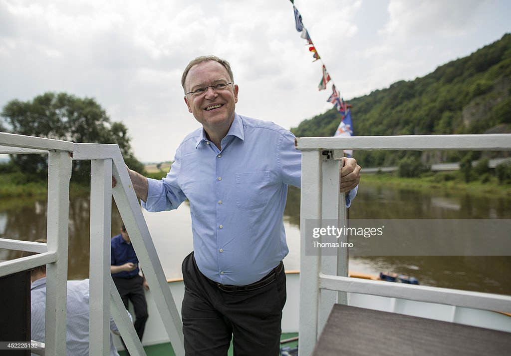 Stephan Weil, Prime Minister of German State Lower-Saxony, stands on deck of a boat during his summertour through lower saxony on July 16, 2014 in Reileifzen, Germany.