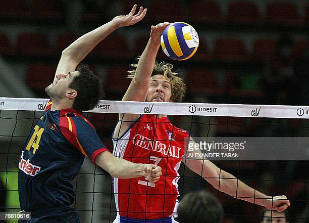 Stephane Antiga of France hits a ball as Jose Luis Molto of Spain blocks during their 2007 Men's European Championships qualification match in...