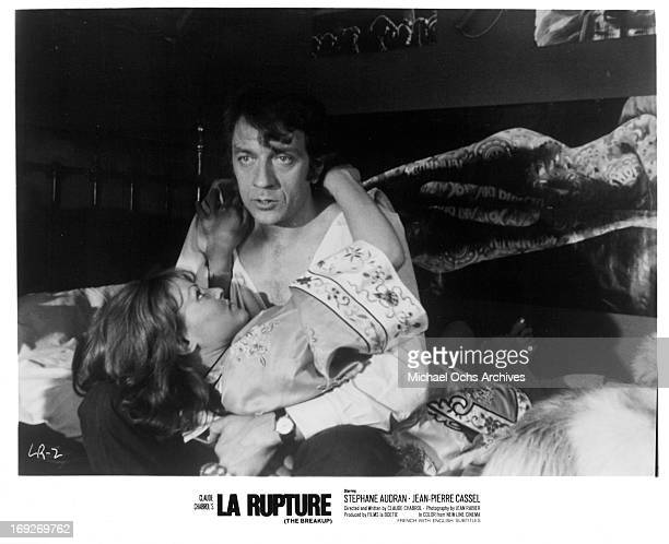 Stephane Audran holding onto JeanPierre Cassel in bed in a scene from the film 'The Breach' 1970