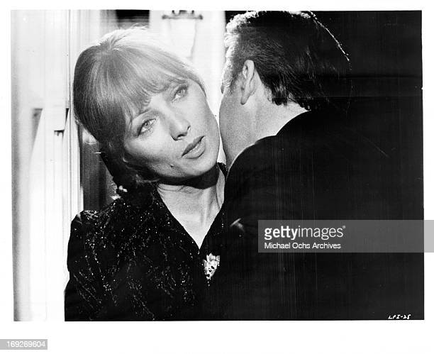 Stephane Audran is admired by man in a scene from the film 'The Unfaithful Wife' 1969