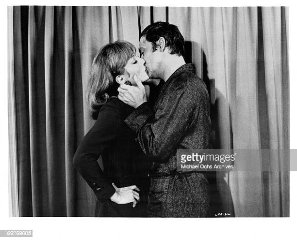 Stephane Audran kissing Maurice Ronet in a scene from the film 'The Unfaithful Wife' 1969