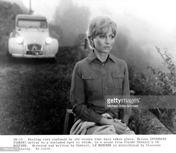 Stephane Audran sits on a ridge in a scene from the film 'Le Boucher' 1970