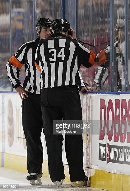 Stephane Auger and Brad Meier wait for the results of a video review during the St Louis Blues and the Nashville Predators game on March 21 2010 at...