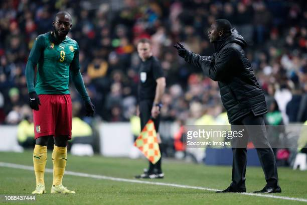 Stephane Bahoken of Cameroon coach Clarence Seedorf of Cameroon during the International Friendly match between Brazil v Cameroon at the Stadium MK...