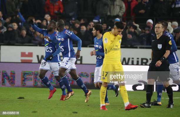 Stephane Bahoken of Strasbourg celebrate his goal and Yuri Berchiche of PSG is disapointed during the Ligue 1 match between Strasbourg and Paris...