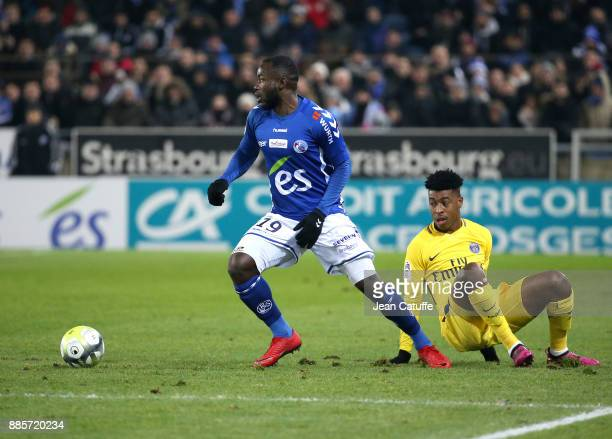 Stephane Bahoken of Strasbourg Presnel Kimpembe of PSG during the French Ligue 1 match between RC Strasbourg Alsace and Paris Saint Germain at Stade...