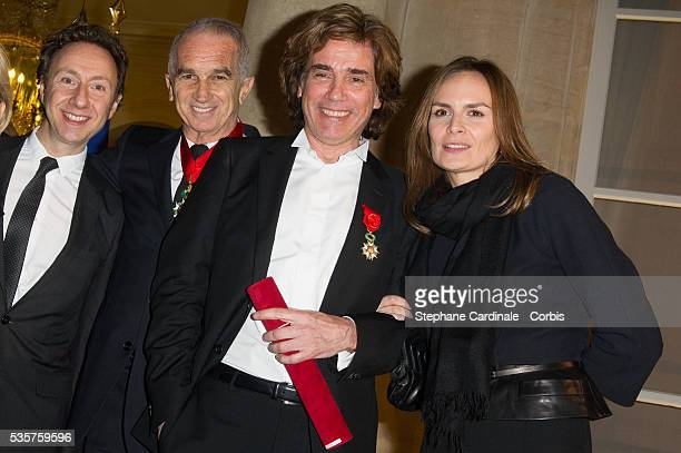 Stephane Bern Alain Terzian Jean Michel Jarre and Brune de Margerie pose after the Ceremony at Elysee Palace in Paris