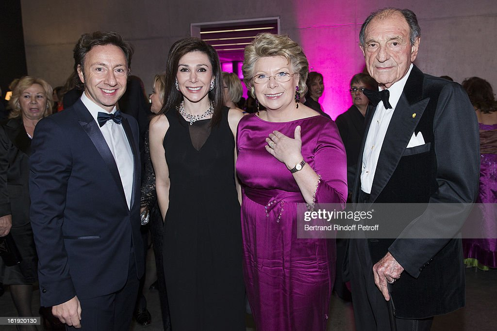 Stephane Bern, French journalist and author, Linda Barras, President of the event, Viviane Reding, Vice-President of the European Commission, and Zahedi Ardeshir, former Iranian diplomat, attend the 30th edition of 'La Nuit Des Neiges' Charity Gala on February 16, 2013 in Crans-Montana, Switzerland.