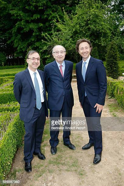 Stephane Bern his Father Louis Bern and his Brother Armand Bern attend the 'College Royal et Militaire de ThironGardais' Exhibition Rooms...