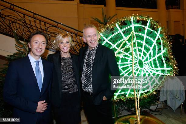 Stephane Bern MarieChristiane Marek and JeanPaul Gaultier pose in front of JeanPaul's Christmas Tree during the 22th Edition of ''Les Sapins de Noel...