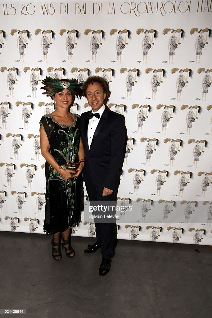 Stephane Bern (R) poses with Florence Reckinger-Taddeï for photocall as he arrives for the 20th Luxembourg Red Cross Ball Gala on November 19, 2016 in Luxembourg, Luxembourg.