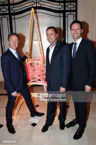 Stephane Bern Prime Minister of Luxembourg Xavier Bettel and his husband Architect Gauthier Destenay pose near the JeanPaul Gaultier's Christmas Tree...